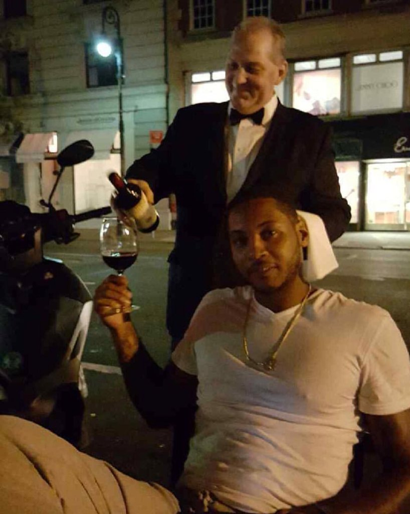 Carmelo Anthony enjoying a nice red.
